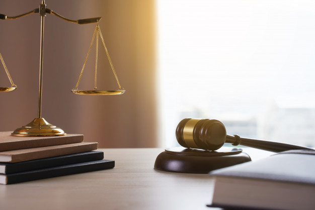 Legal desk with scales of Justice and a gavel and book