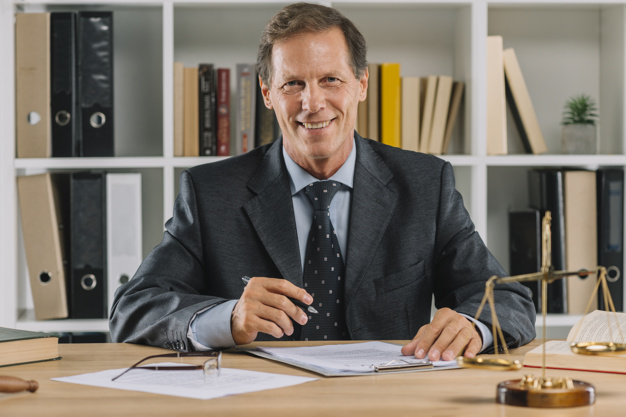 Smiling lawyer at his desk
