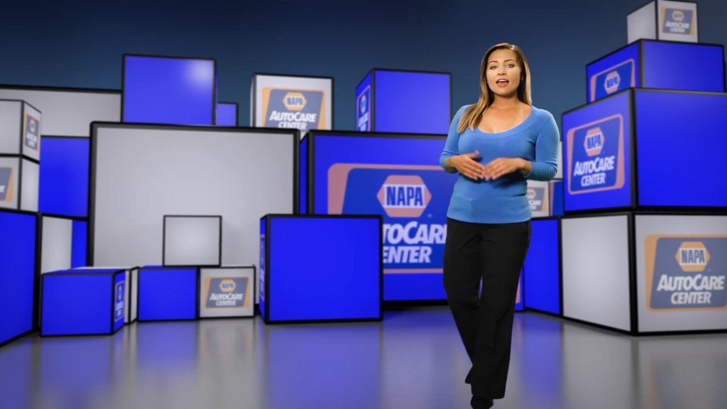 NAPA AutoCare spokeswoman with a Customer Satisfaction sign